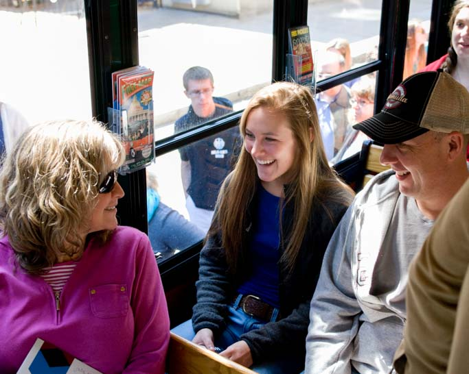 Student and family on trolley tour.