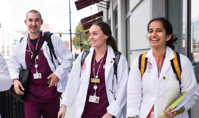 MCPHS students walking on the street.