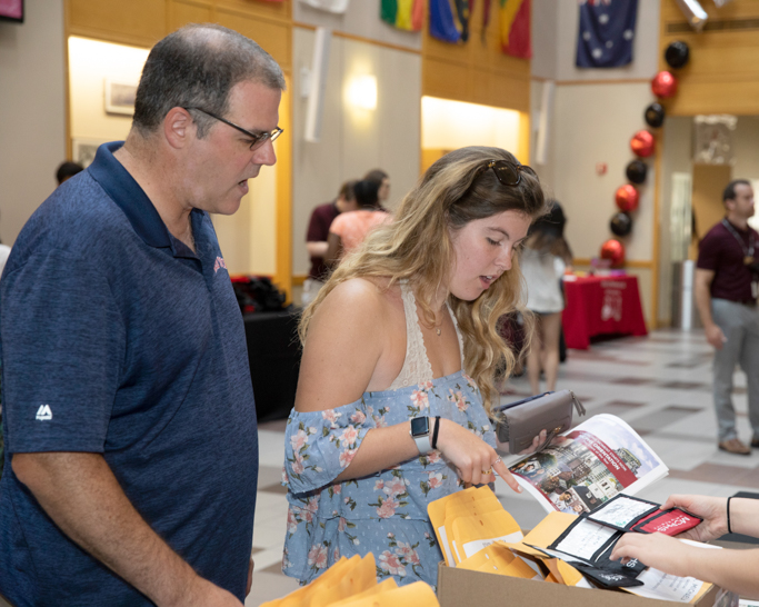 MCPHS student receiving welcome packet at Orientation.