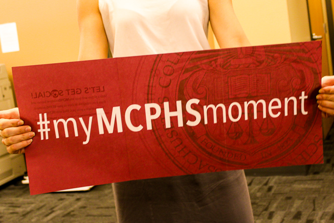 "Student holding sign that says ""#myMCPHSmoment"""
