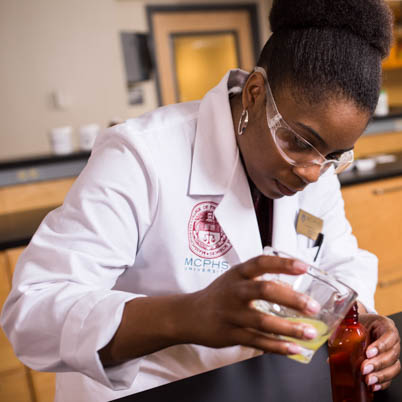 A student works in the Manchester Pharmacy lab.