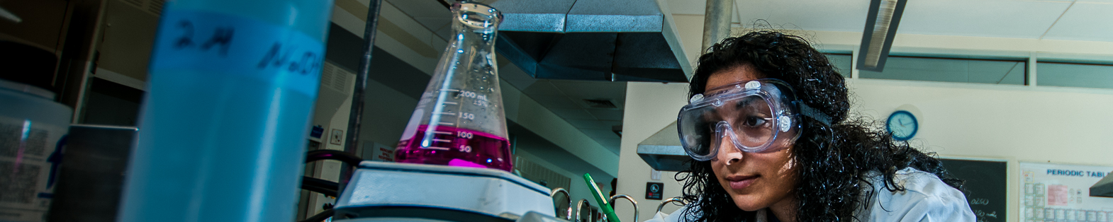 Student in lab with flask