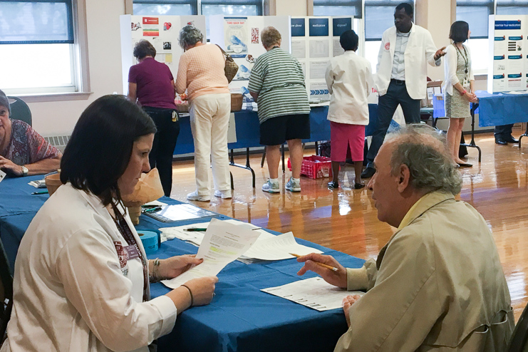 MCPHS Students provide preventive health screenings for older adults.