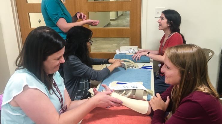 Occupational Therapy students fabricate a splint to prevent joint movement and tendon use.