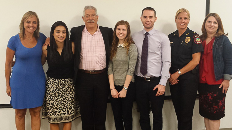 PharmD students present on reversing an overdose with naloxone.
