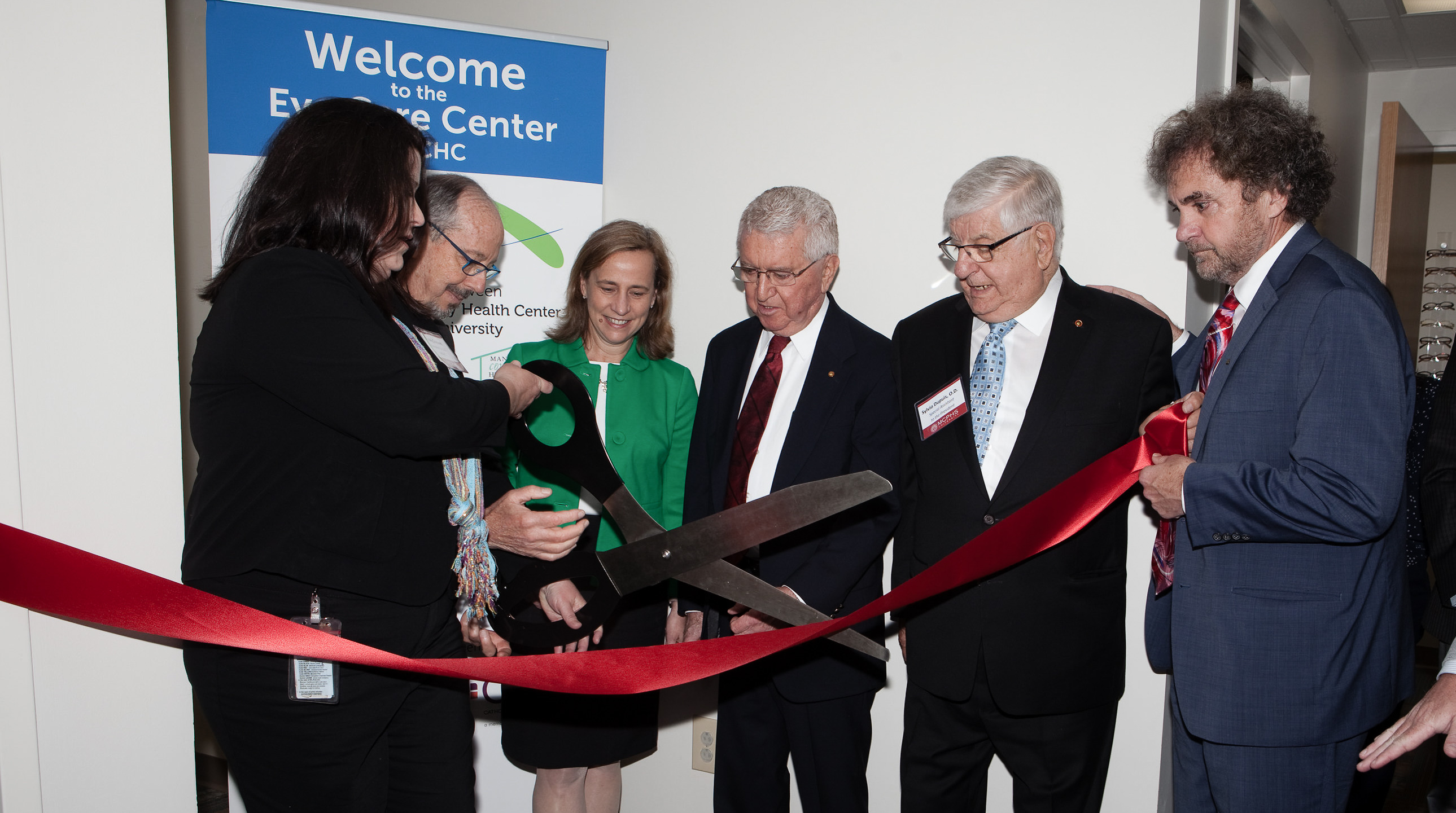 Cutting the ribbon at the opening of the new MCPHS Eye Care Center at Manchester Community Health Center.