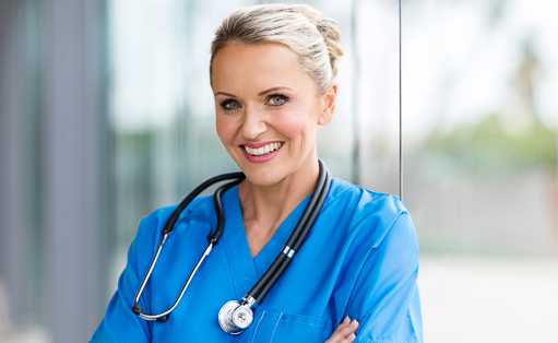 Nurse standing in front of window.